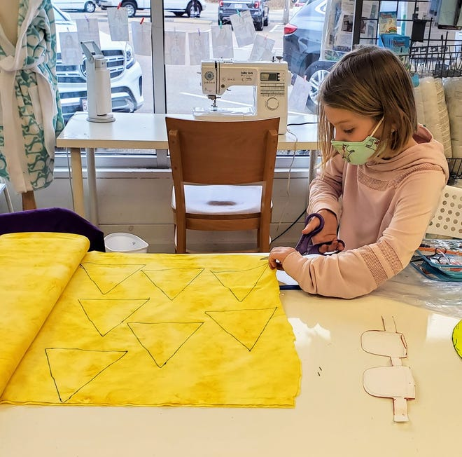 The Makery fashion show was cancelled this year, so sewing students like seven-year old Faye McCarthy took part in a sewing contest.  Faye created a sun wearing sunglasses.