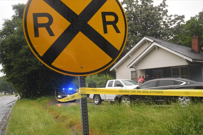The Anderson County Sheriff's Office investigators and coroner office process the scene on Diamond Street in Anderson.