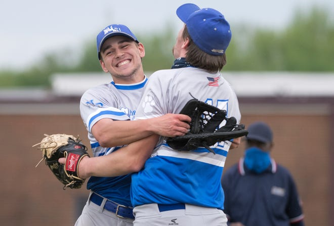 Northern Burlington's Richie Brown-Luden, left, celebrates with teammate CJ Fredericks after Northern Burlington's 4-1 victory over Rancocas Valley at Northern Burlington County Regional High School on Monday, May 3, 2021.