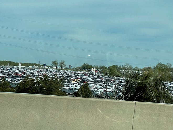 Thousands of pickup trucks could be seen from I-71 in Sparta, Kentucky on Sunday, May 2, 2021. Ford Motor Co. had approximately 22,000 vehicles at the end of March primarily in North America awaiting installation of chip related components, Chief Financial Officer John Lawler said during a first quarter earnings call with analysts on April 28, 2021. These appear to be Super Duty trucks, which are made by UAW members at the Kentucky Truck Assembly Plant in Louisville.