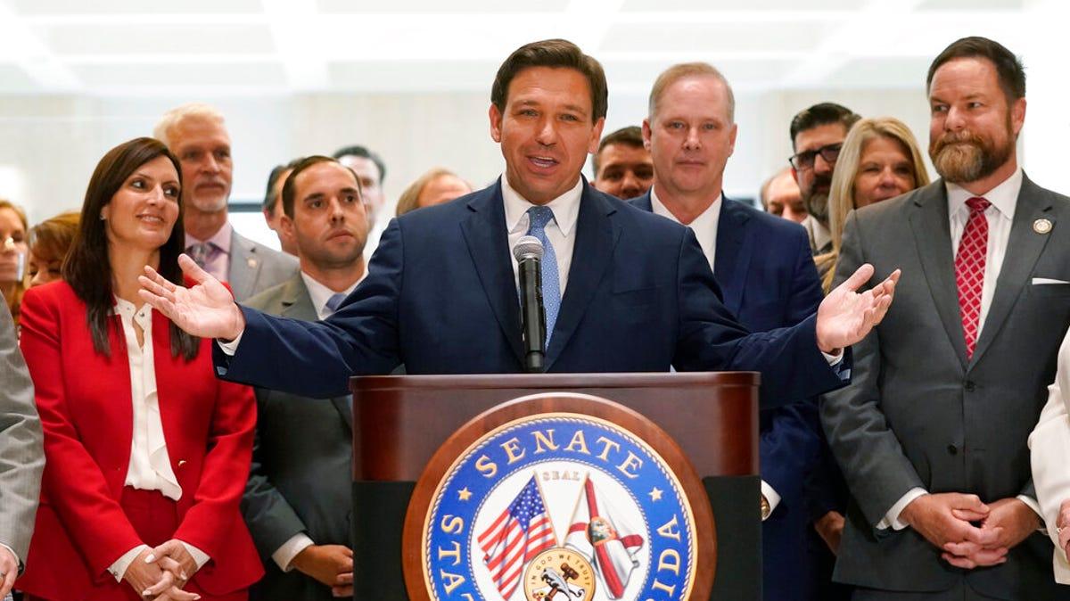 Florida gov signs GOP voting law critics call 'un-American' 2