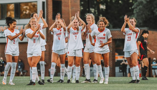 Greenville's Caroline Conti (far right, No. 23) and her Clemson teammates celebrate a win against Rutgers in the NCAA women's soccer tournament.