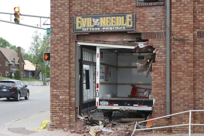 Evil by the Needle, a tattoo studio on South Walnut Street, was struck by a U-Haul truck late Sunday afternoon. The vehicle went completely inside the building before stopping. People reportedly were inside the business at the time, but police were not releasing any details Sunday on possible injuries.