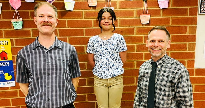 Galion fifth-grade student Bella Alberty (center) was selected as a member of the American Automobile Association (AAA) Safety Patrol Hall of Fame for the 2020-2021 school year. She was nominated by Safety Patrol Advisor Adam Lehman (left) and Galion Intermediate School Principal Alex Sharick (right).