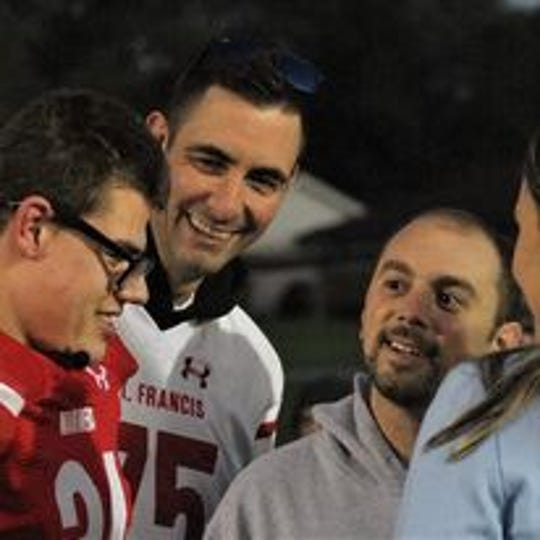 St. Francis High School Principal Mike Lewandowski (second from left) is seeking a kidney donor to help solve a lifelong health issue.