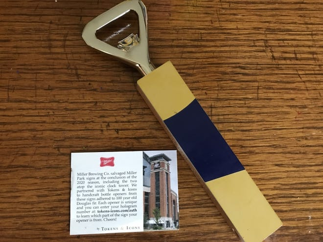 """Bottle openers fashioned from the Miller Park """"clock tower"""" are being given away to fans."""