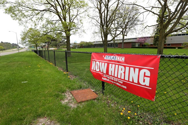 A hiring sign is seen outside Strattec Security on West Good Hope Road, in Milwaukee on Monday, May 3, 2021. Roadside signs about job openings are increasingly common as demand for more workers increases. As Wisconsin's unemployment rate continues to stay below 4%, businesses are running into a different problem - not enough workers.