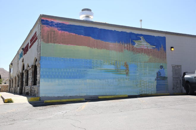 A mural in its beginning stages will eventually depict migratory species frequently seen in the southern border region, on the side of Carlos' Bakery at 2101 McNutt Road in Sunland Park, N.M., on Monday, May 3, 2021.