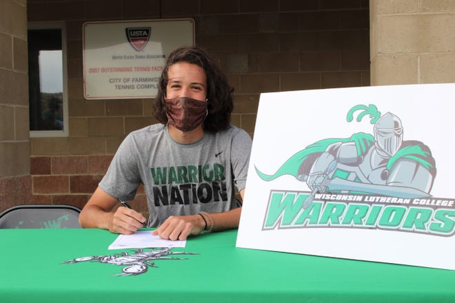 Farmington's Asa White signs his National Letter of Intent on Monday, May 3, 2021, to continue his tennis career at NCAA Division III Wisconsin Lutheran College.
