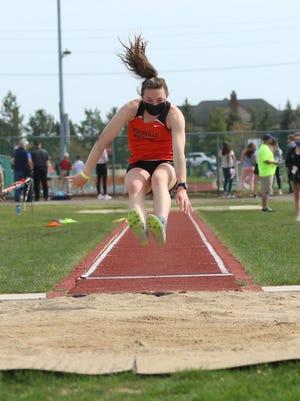 Senior Keira Courtney long jumps against Hartland.
