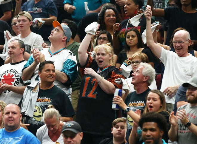 Arizona Rattlers fans celebrate a touchdown against the Sioux Falls Storm in the first half during the United Bowl on July 13, 2019 at Gila River Arena in Glendale, Ariz.