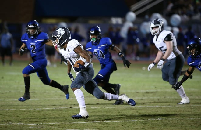 Oct 9, 2020; Chandler, Arizona, USA; Pinnacle Pioneers wide receiver Dorian Singer (1) runs the ball against the Chandler Wolves at Chandler High School. Mandatory Credit: Rob Schumacher/The Arizona Republic via USA TODAY NETWORK