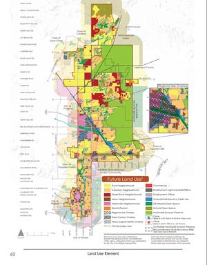 City Council discussed creating a new land use in north Scottsdale, named Desert Rural Neighborhoods, identified in red in the map. After the State Land Department objected to a proposal, the council decided to strike the proposal from a plan aimed at guiding city growth.
