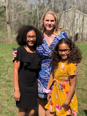 Linda Burnett of New Egypt, New Jersey with her daughters Alana,, 12, and Avery, 10.