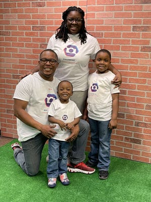 Glenda Simmons of Rochester with her husband Roy, and sons Gavin, 7, and Royce, 3.