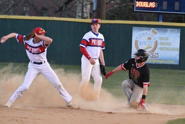 Brandon Valley's Tyler Schelske is safe at second base against Douglas on Friday, April 30, 2021.
