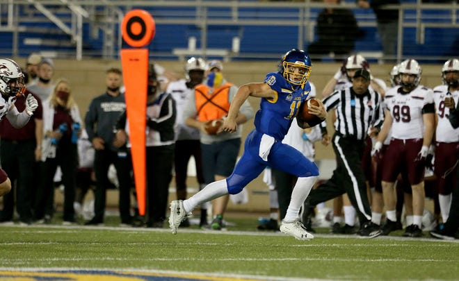 South Dakota State's Mark Gronowski looks for a defender on a 67-yard touchdown against the Southern Illinois.
