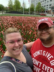 Brian Merce and his wife Courtney visited Ohio State Wexner Medical Center for a check-up last week. The 11,000 pinwheels on the transplant center's lawn represent each organ transplant performed at the Columbus hospital.