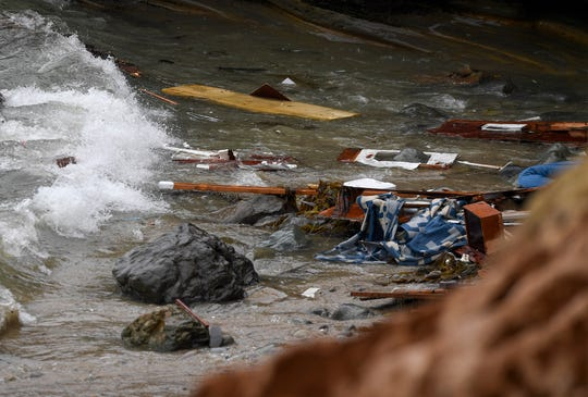 Debris and debris from an overturned boat were washed ashore at the Cabrillo National Monument near where the boat capsized right off the coast of San Diego on Sunday, May 2, 2021.
