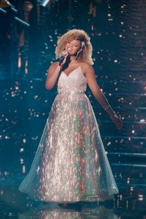 """Rocking a sparklingball gown, college student Alyssa Wray dazzled with a magical performance of """"ADream Is a Wish Your Heart Makes"""" from """"Cinderella."""""""