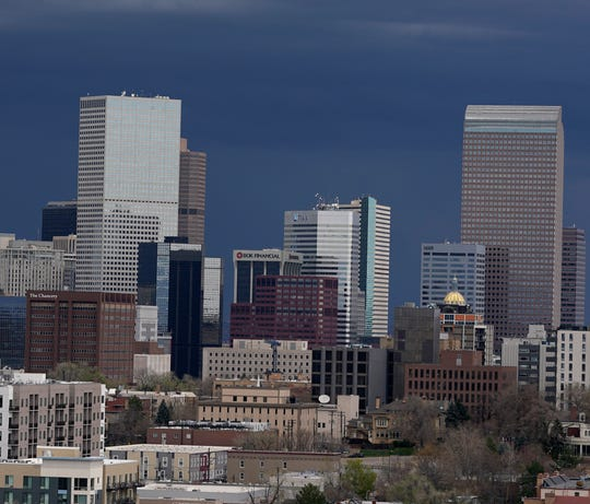 Storm clouds are pictured moving over the skyline in Denver. Forecasters predict that the stormy weather will be on tap from Sunday through Tuesday as a cold front packing heavy rains, cooler temperatures and possibly hail will settle over the intermountain West.
