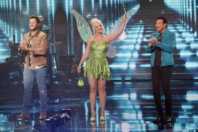 """As usual, the singers got feedback from judges Luke Bryan, left, Lionel Richie and Katy Perry, who celebrated the night's theme by dressing as Tinker Bell from """"Peter Pan."""""""