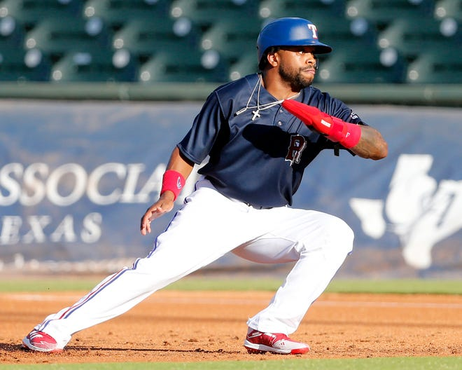 Round Rock Express left fielder Delino DeShields scrambles back to first base during a scrimmage versus the Houston Astros on Sunday at Dell Diamond. DeShields returned to the Texas Rangers organization after one year with the Cleveland Indians.