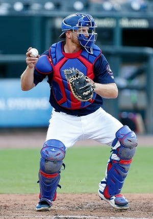 Round Rock catcher John Hicks fires the baseball to second base during an extended spring training game versus the Houston Astros in May. Hicks joined parent club Texas Rangers in June and was sent back down to the Express after a successful stint in the majors.