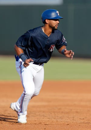 Round Rock Express center fielder Leody Taveras gets ready for the play in a game earlier in the season. Taveras, rated among the topTexas Rangers prospects, has a 10-game hitting streak during which he is batting .385.