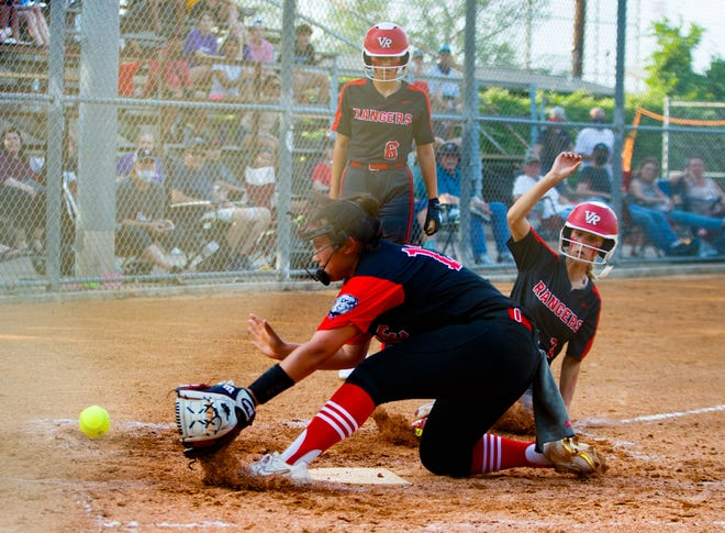 Vista Ridge's Savannah Cockerill is safe at home on the late tag by Bowie's Emma Solis during the fourth inning at the Class 6A bi-district playoff against Bowie on Monday at Butler Field in Austin. Bowie won the third game of the best-of-three series to advance to the second round.