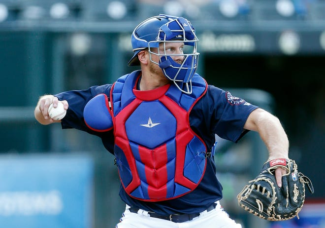 Round Rock Express catcher John Hicks fires the baseball to second base during the team's scrimmage against the Houston Astros on Sunday at Dell Diamond. The former Virginia star is firmly entrenched as the team's starting catcher.