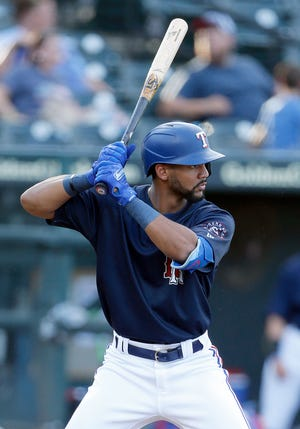 Round Rock Express center fielder Leody Taveras takes a turn at bat against the Houston Astros at spring training game in May. Taveras, along with five other Express squad members were called up by the Texas Rangers this week.