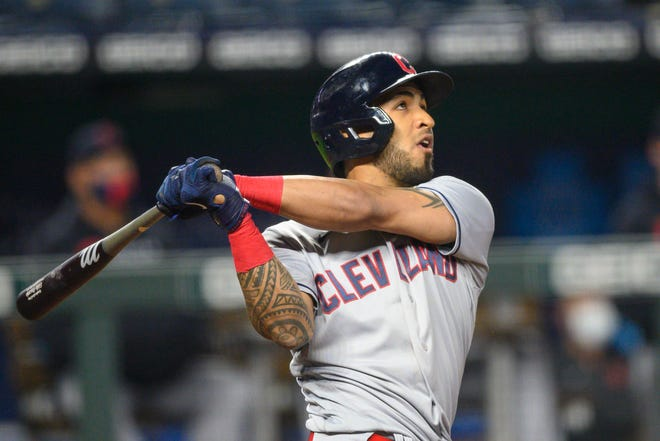 Cleveland left fielder Eddie Rosario watches his three-run home run in the seventh inning of an 8-6 win over the Kansas City Royals on Monday night. [Reed Hoffmann/Associated Press]
