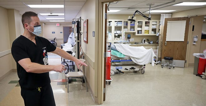 Dr. Sonny Bare shows off one of Western Reserve Hospital's trauma bays Tuesday. The Cuyahoga Falls hospital has been certified as a trauma center.