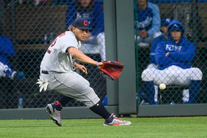 Cleveland right fielder Josh Naylor fields a single by Kansas City Royals' Whit Merrifield during the first inning of Cleveland's 8-6 win Monday night in Kansas City. [Reed Hoffmann/Associated Press]