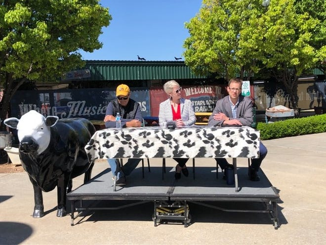 Executive Director Zack Wilson, far right, speaks during Tuesday's news conference, announcing the Foodstock '21 concert series, benefiting the High Plains Food Bank. Tina Brohlin, a representative from the food bank, and Bobby Lee, the co-owner of the Starlight Ranch, participated in the conference.