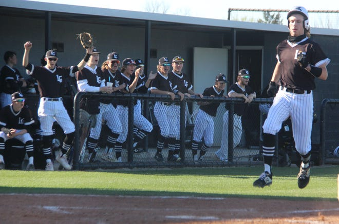 Lone Grove's Gavin Peery, right, scores a run earlier this season as his teammates celebrate. The Longhorns host Perry at 11 a.m. Thursday, May 6 in the opening round of a Class 3A Regional.