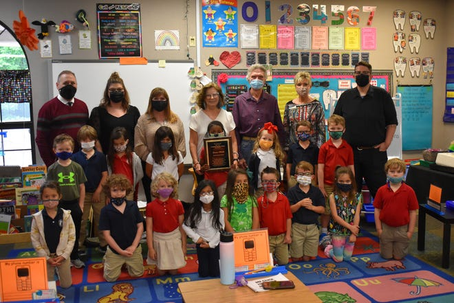 Pictured from left: Kevin Butler, American Nation Bank; TiAna Nelson, The Ardmoreite; Melinda Dudley, Craddock Funeral Home; Jimmie Wallis, The Ardmoreite's 2021 Area Amazing Teacher; Bill Wallis, husband of Jimmie Wallis; Dawn Shebester, BancFirst; Robby Short, The Ardmoreite; and Wallis' kindergarten class at Oak Hall Episcopal School. Jimmie Wallis was presented with The Ardmoreite's 2021 Area Amazing Teacher Award sponsored by Patriot Auto of Ardmore, Ideal Home Care, American Nation Bank, Hunter SuperTechs, Craddock Funeral Home, First National Bank, Quality Electric, Pure Wellness, Arbuckle Communications, Michelin, Ardmore Hearing, BancFirst, Noble Foundation, Cross Timbers Hospice, The UPS Store, Murray State College and The Ardmore Institute of Health.