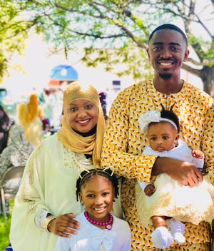 Dr. Jubril Oyeyemi and his family stand for Eid pictures at GCLEA mosque in Cherry Hill during a previous year. The family usually celebrates with barbecue food.