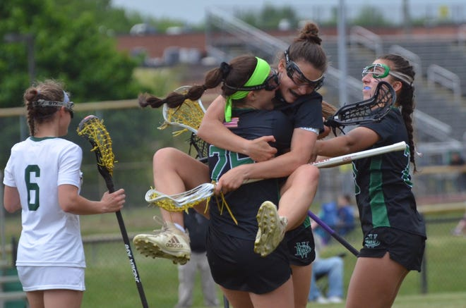 West Deptford attacker Avery Corino jumps into Antonia Gismondi's arms after Gismondi scored the 100th goal of her career
