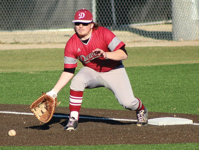 MIchel Caswell prepares to scoop up the ball to record an out in Dewey High baseball action earlier this season.