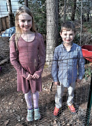 Riley, 8, and Dylan, 6, bring joy chatting at the fence as neighbors do. [BOB DALY]