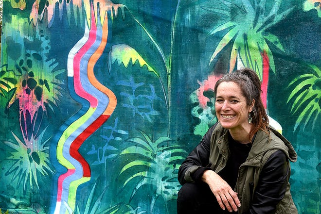 True/False Film Fest artist Kristina Rolander poses with her art installation called The Sapling on Tuesday as she sets up her exhibit for the festival at Stephens Lake Park. Rolander's art features mixed media, sculpture and paintings. The festival begins Wednesday.