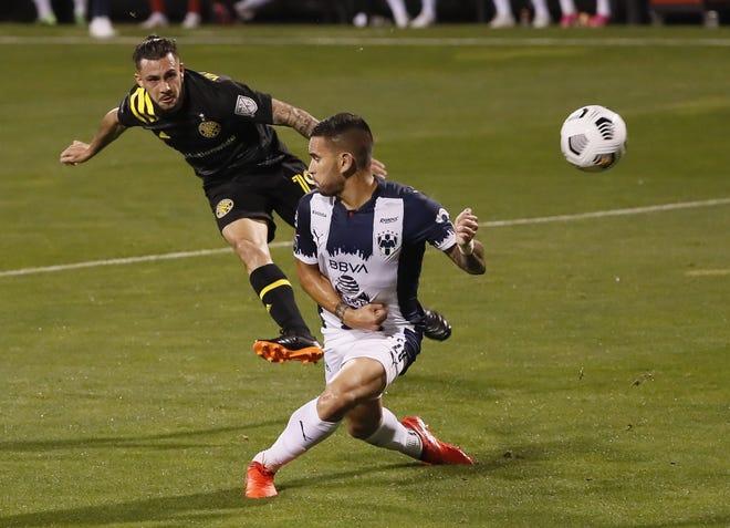 Columbus Crew SC defender Milton Valenzuela (19) fires a shot past CF Monterrey defender Sebastián Vegas (20) in the first half of the first leg of the CONCACAF Champions League quarterfinals at Crew Stadium in Columbus on Wednesday, April 28, 2021.