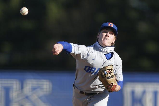 Olentangy Orange's Josh Laisure (12) delivers a pitch against Worthington Kilbourne during a boys baseball game at Worthington Kilbourne High School Friday, April, 2, 2021.