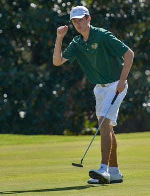 Lake Minneola's Jonathan Yaun pumps his fist after making a putt during the 2017 Class 3A FHSAA state championship at Mission Inn in Howey-in-the-Hills. Yaun went on to win the state title. [PAUL RYAN / CORRESPONDENT]