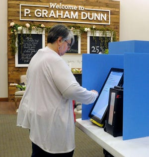 Ann Torgler votes at P. Graham Dunn in Dalton. Sugar Creek Township residents had one issue on the May 4 special election ballot.