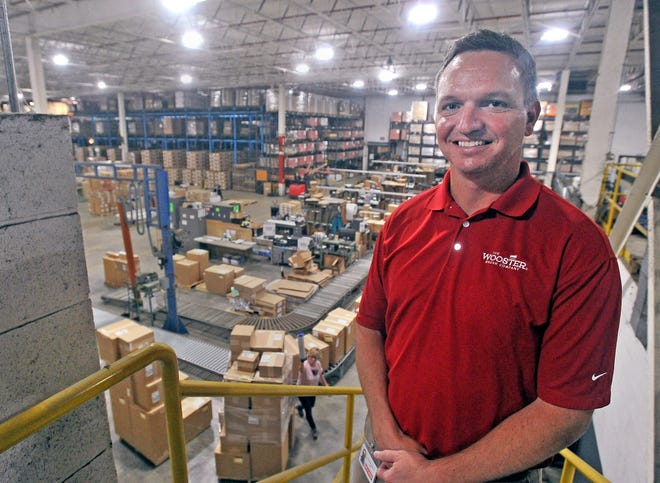 Ben Maibach, Wooster Brush Co. president,  in the factory with the shipping department busy in the background. He earned the Leadership Wooster alumni award from the Wooster Area Chamber of Commerce.