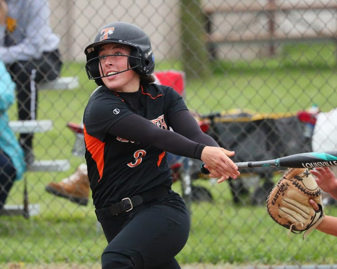 Tecumseh's Emma Newlove watches the ball fly after hit during Monday's doubleheader against Adrian.