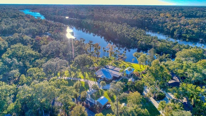 This gated riverfront estate, sitting on 5.25 acres in the heart of The Trails, is a boater's paradise.
